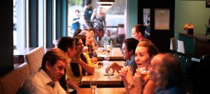 people socializing at the restaurant 300x135 - people socializing at the restaurant